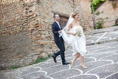 The newlyweds running barefoot in Pesaro, Italy with photos by Daniele Del Castillo | via junebugweddings.com