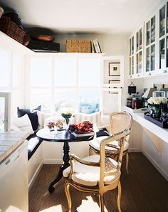 Add shelving over windows for extra space in the amazing petite dining space.