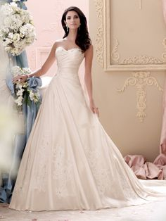 David Tutera Asymmetrical wedding dress, strapless hand-beaded corded lace appliques and memory taffeta full A-line gown, soft sweetheart neckline trimmed with hand-beaded corded lace appliques, direc