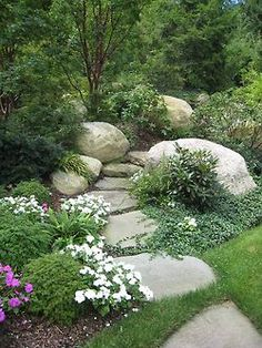 Love this; the ground cover, trees and other plants are beautiful. The larger stones offer visual impact and seating; love that.(bh)