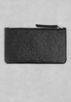 Simple and elegant, this embossed leather pouch is perfect for storing your on-the-go essentials.