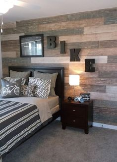 Faux plank wall I recently painted in Richmond, VA for Terri Kemp Interiors. The wall was taped and each faux plank was painted separately for a varied look in this teen boys room. It took some time but I love the way it turned out. Teen Boy Rooms, Teenage Room, Boy Teen Room Ideas, Bedroom Ideas For Teen Boys, Teenage Boy Bedrooms, Boys Room Paint Ideas, Teen Boys Room Decor, Boys Bedroom Paint, Teen Boy Bedding