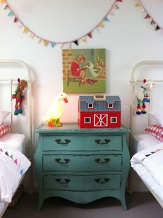 I have two antique twin beds. Thought about setting them up like this with a pink painted dresser in the middle for both the girls when we get our house in the states!