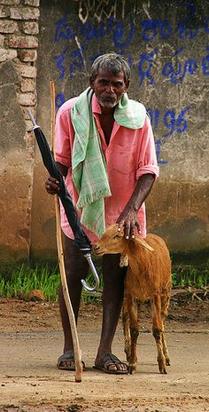 man and his goat by Michael Hirshon, via Flickr  #goatvet says both obviously care for each other