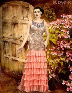 Sue Wong pink champagne long gown with embellished torso and pleated tier skirt…