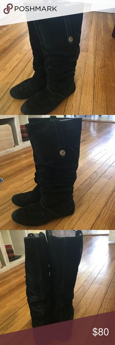 Ugg boots Authentic suede Ugg boots. Black with wooden soles and wooden button on each side. Worn a decent amount but sill in great condition. UGG Shoes Ankle Boots & Booties