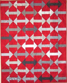 QM Scrap Squad: For her final Scrap Squad assignment, Kathy Wagner created a wonderfully scrappy red and gray version of the Which Way to Go? quilt pattern from Quiltmaker's Sept/Oct 2015 issue.