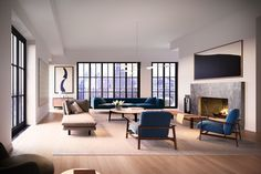 The living room in the penthouse allows for several seating areas and leads graciously into the formal dining room. The room is anchored by a modern Mariana soapstone fireplace and surrounded by floor-to-ceiling windows with year-round natural light.