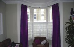 Interlined, pinch pleated silk curtains on baypole with cafe shutters Crouch End