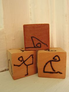 Wooden Hand-burned Yoga Game Dice great for kids' yoga classes! 3 dice with 18 poses in a custom muslin bag