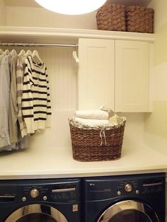 Love this laundry room set up. Countertop over front loading machines. One cabinet for closed storage, and a simple rod for air drying clothes. This is happening!