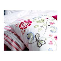 IKEA Alvine Flora cushion. Our bedroom decorative pillows, which are pretty much NEVER on the bed.