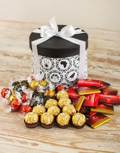 Buy or Send 50 pieces of assorted imported chocolates, delivered in a gorgeous hatbox, tied with a ribbon. Ideal for anyone who loves a lot of chocolate in South Africa. Chocolate Gifts, Chocolate Box, Floral Arrangements, South Africa, Snacks, Packaging Ideas, Stuff To Buy, Chocolates, Ribbon