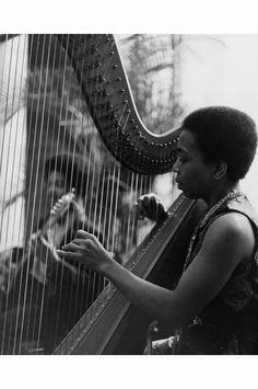 Dorothy Ashby Trio View of the Dorothy Ashby Trio, showing harpist Dorothy Ashby performing with guitarist and drummer. Handwritten on back 1971-06-20 © E. Azalia Hackley Collection  Dorothy Ashby…