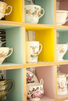 Upcycled CD unit - I've been looking for a tea cup display!