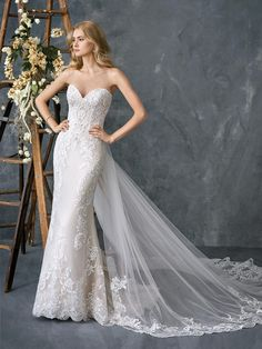 Kenneth Winston Style 1775 | Sheath | Sweetheart | Dropped Waist | Semi-Cathedral Train | Materials: Embroidered Cotton Lace/English Net/Organza/Stretch Satin (Detachable Train Included) | Color Options: Champagne/Ivory Silver (Pictured) - Ivory/Ivory Silver - White/White Silver