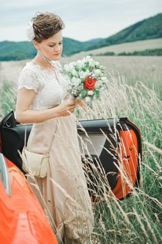 bride and red car