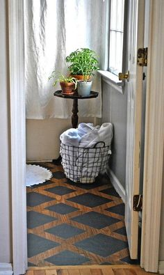 Try paint for a custom look on wood floors - a small budget with great results!