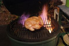 Flame ON !  Big Green Egg cooking is just the best. I dropped the temp of this hot fire to 325º and set a timer for 1 hour.  I did turn the birdy at about 40 minutes.