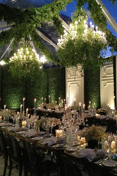 Transform a tent into an enchanted garden with grassy walls and ivy-covered chandeliers.Related:How to Bring the Outside In at Your Wedding