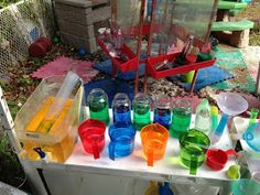 "Brita, clear tube, measuring cups, recycled pasta jars, bottles with water, waterway pipe builders ("",)"