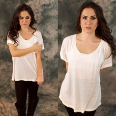 White Thin Knit Tee Amazing basic, perfect for the fall weather and layering with leggings or jeans. 65% cotton 35% polyester. Hand wash only. I have small medium and large available, please contact me to make your own listing! Lewboutiquetwo Tops Tees - Short Sleeve