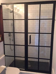 Grallcrafters' Metropolis Series framed shower doors, influenced by Tudor window architecture, fabricated with grid pattern, luxurious black metal finishes Shower Sliding Glass Door, Framed Shower Door, Shower Doors, Modern Shower, Modern Bathroom, Bathroom Ideas, Half Walls, Shower Enclosure, Guest Bath