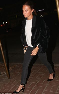 Venus in furs! The Swedish beauty looked pretty and polished in a faux fur bomber jacket, ...