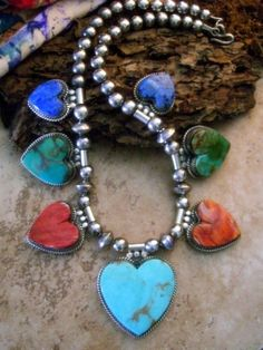 *Native American Indian Navajo Necklace and Earring Set of Repeating Heart Pendants. Handcrafted by Glenda ConchausingKingman Mine Turquoise, Pilot Mountain Turquoise, Lapis Lazuli, and Spiny Oyster with classic Sterling Silver beads.