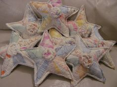Fabric stars created by me from vintage cutter quilts