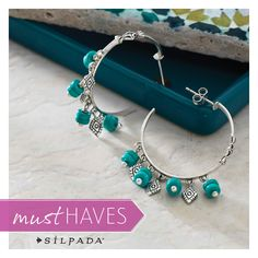 Boasting alternating drops of turquoise-hued beads and diamond-shaped sterling silver details, these hoops make a statement all their own. #SilpadaStyle