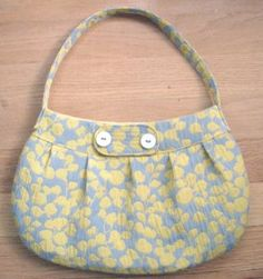 Buttercup Bag -  With this free purse pattern, sew your own buttercup bag. This purse is stylish and the perfect size for a day of shopping.