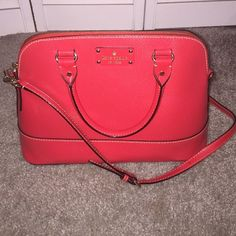 Kate Spade Handbag Red Kate Spade bag with pink inside.. In great condition only those two marks on front which are barely noticeable kate spade Bags Totes