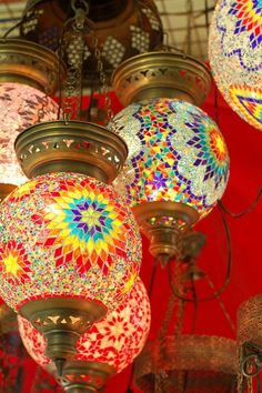 Pretty Colored Mosaic Pendant Lights Gonna try flat marbles on mason jars & make these using mason jar chandelier idea