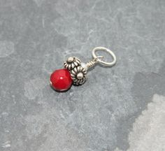 Faceted round red coral bead accented with by jewelrybybellagrace