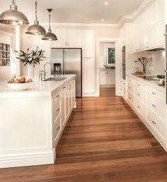 white kitchen, hardwoods in kitchen, 3 pendant lights in kitchen, bright kitchen #whitekitchen #kitchen #kitchendesign