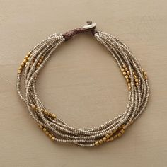 """BYWAYS BRACELET�--�Eight strands of metal and brass beads travel to and from a macram� clasp fastened by a cast sterling silver sequin button. USA. Exclusive. 7-1/2""""L.~<3"""