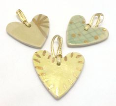 Three handmade hearts - perfect for gift wrapping or as tree ornaments - all yellow, gold & green. By Servant Ceramics Hearts, Gift Wrapping, Hand Painted, Ceramics, Ornaments, Yellow, Unique Jewelry, Handmade Gifts, Green