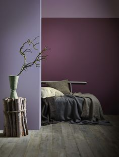 A room decorated in time for Autumn. Addiction purple (back wall) with Just Plum (left wall) and Cover Story (top wall) mixes warm colour tones with foliage.