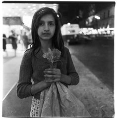 Diane Arbus 1923-1971, was an American photographer who became famous for her black and white square photographs of quirky looking people.