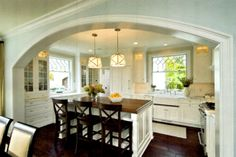 This was an inspiration image. We could not afford an arch, but we did do a beam. We did to white trim and a blue-grey paint job. We did get the dark wood floor.