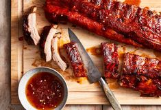 NYT Cooking: These simple, snackable ribs are slow cooked until they are very tender. Then the ribs are brushed with spicy honey, and broiled for 2 minutes to caramelize. Don't worry that the ribs go into the slow cooker without liquid Rib Recipes, Slow Cooker Recipes, Crockpot Recipes, Parmesan Soup, Spicy Honey, Stuffed Peppers, Cooking, Crock Pot, Crockpot