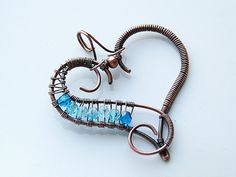 Copper wire wrapped heart pendant with blue fire by DeFactoryshop, zł40.00