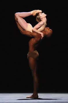 Love the contrasting colors and the shape of the photo of these two dancers.