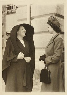 The Queen speaking to a Maltese lady wearing the traditional 'għonnella' – the Queen and Prince Philip lived in Malta for two years towards the end of the 1940s.