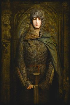 Woman wearing full mail and green cloak, holding a sword. By Krzysztof Czyż