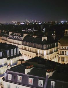 Paris rooftops at night.