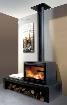 "Against the wall or installed in the center of the room, fireplace stove is placed on a console or 175 x 70 x h. ""Linéo"" from € Don-Bar. Home Fireplace, Modern Fireplace, Fireplace Design, Fireplaces, Fireplace Ideas, Home Living Room, Living Room Designs, Freestanding Fireplace, Log Burner"