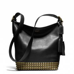 Oh, hello friend. Coach Legacy Duffle in studded leather. #swoon