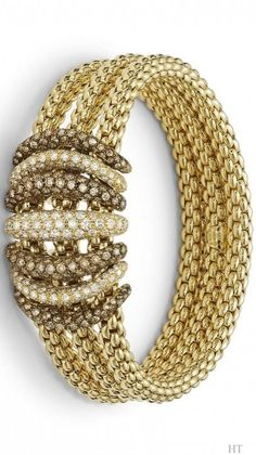 Three bracelet in 18Kt yellow gold flexible featuring the Novecento mesh with microset diamond pavè by Fope. , HT